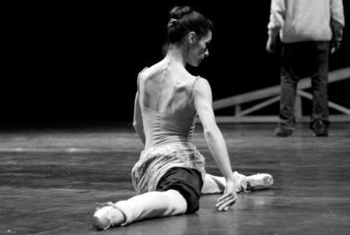 A ballerina warming up